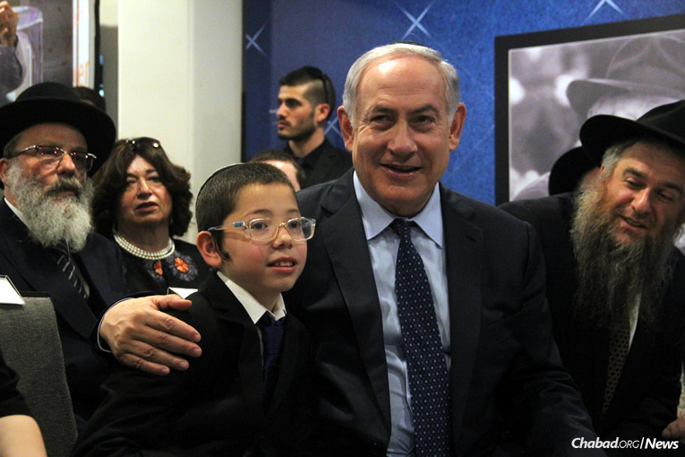 Israeli Prime Minister Benjamin Netanyahu and Moshe Holtzberg at Nariman (Chabad) House in Mumbai, India. With them are Moshe's paternal grandparents, Rabbi Nachman and Freida Holtzberg, left, and Rabbi Yosef Chaim Kantor, right, co-director of Chabad of Thailand. (Photo: Chabad of Mumbai/Chabad.org)