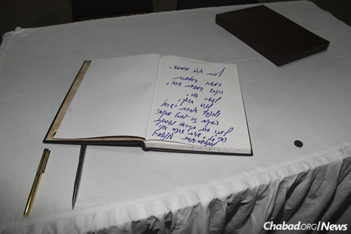 """Israeli Prime Minister Benjamin Netanyahu wrote in the guest book at Nariman House: """"To the Chabad House of Mumbai: Continue in your holy work as instructed by the Rebbe, to kindle light, to banish the darkness and to spread Ahavat Yisrael, love of your fellow, in this place and all over! In memory of Rabbi Gavriel and Mrs. Rivka Holtzberg, of blessed memory, whose memory we revere."""" — Benjamin Netanyahu (Photo: Chabad of Mumbai/ Chabad.org)"""
