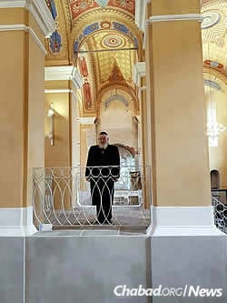 Mangel stands in a historic synagogue in Bardejov. The village of Kurima, where his grandparents resided, is in Bardejov district.