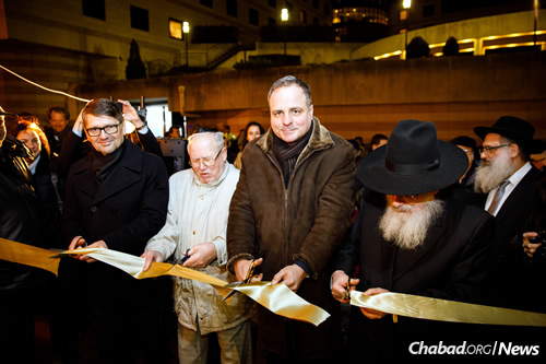 From left: Cutting the ribbon are Maďarič; Dr. Pavol Traubner, President Emeritus of the Federation of Jewish Communities of Slovakia; Droba; and Mangel.