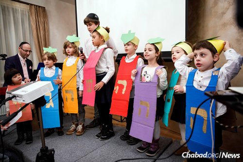 Children at Chabad's preschool perform a Chanukah show.