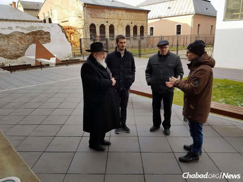 With a guide in the city of Bardejov, Slovakia. To Mangel's right is his grandson, Ari Herson.