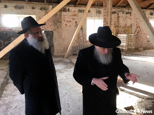 Rabbi Baruch Myers, co-director of Chabad-Lubavitch of Slovakia, left, looks on as Mangel shares memories at the Sereď concentration camp, where he and his family were taken immediately after their arrest, about an hour from Bratislava.