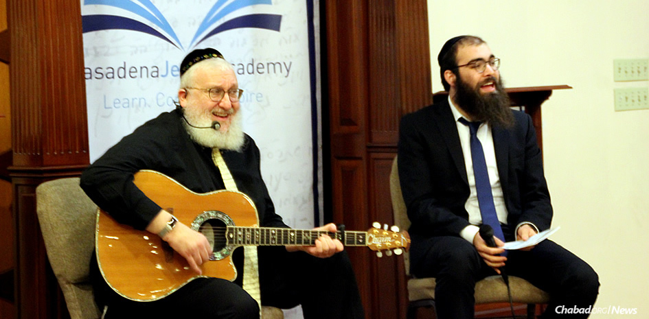 "The first of five events for a new program called ""Torah Through the Arts,"" developed in California by Rabbi Zushi Rivkin, right, featured musician and songwriter Rabbi Chaim Fogelman, who performed for the audience and offered Torah inspirations related to the music."
