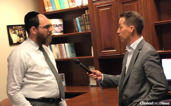 Rabbi Hershey Bronstein, left, seen here being interviewed by a CBS news reporter, alerted the FBI and local authorities to the camera footage showing Cruz's path.