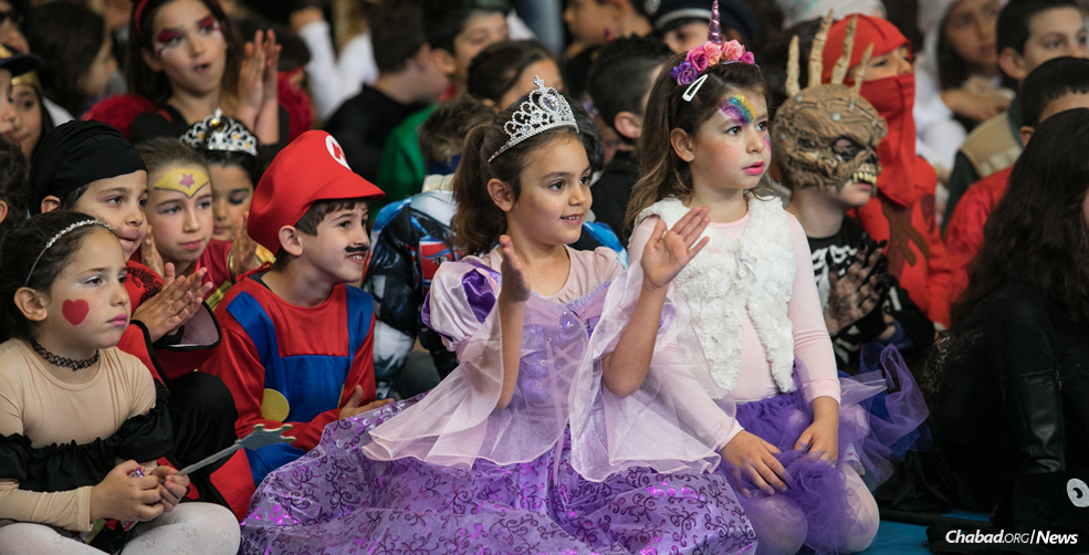 People around the world, especially children, are preparing for Purim, which begins on Wednesday night. (Photo: Anat Hermony/Flash90)