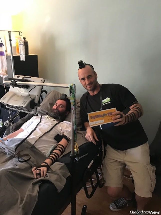 Putting on tefillin with Rabbi Yitzi Hurwitz in Los Angeles.