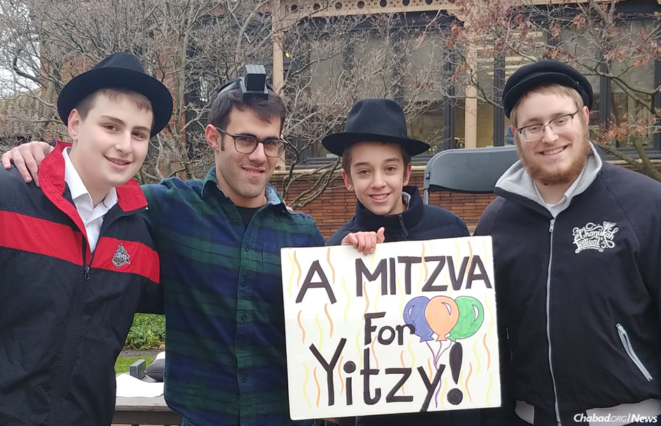 Ten thousand people in 15 countries, like this group in Pittsburgh, did extra mitzvahs to honor the 46th birthday of Rabbi Yitzi Hurwitz, who has ALS.