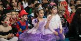 Festivity Prevails as World Preps for Purim