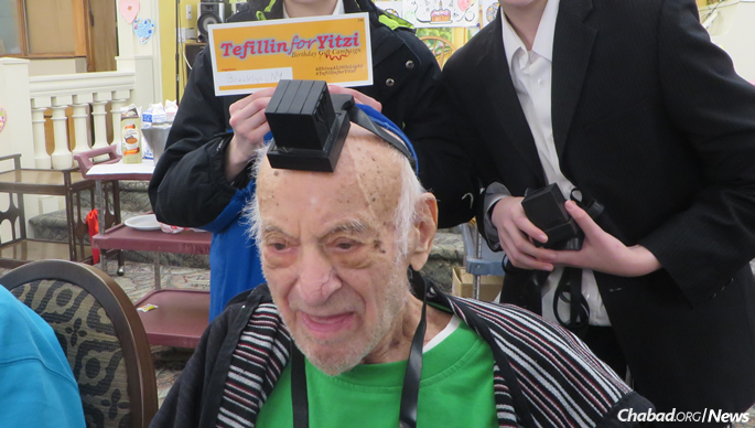 In Brooklyn, students helped a 105-year-old man put on tefillin.