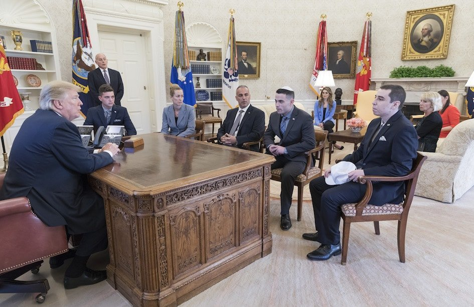 Meadow Pollack's family meeting with President Donald Trump, left, at the White House. Her brother, Hunter, says he wore a kippah to send a message that his peers should ''be proud to be Jewish.'' From left, around the desk: Brandon Schoengrund, Julie Phillips-Pollack, Andrew Pollack, Hunter Pollack and Huck Pollack. Standing by the door is White House Chief of Staff John Kelly. (Official White House Photo by Shealah Craighead)