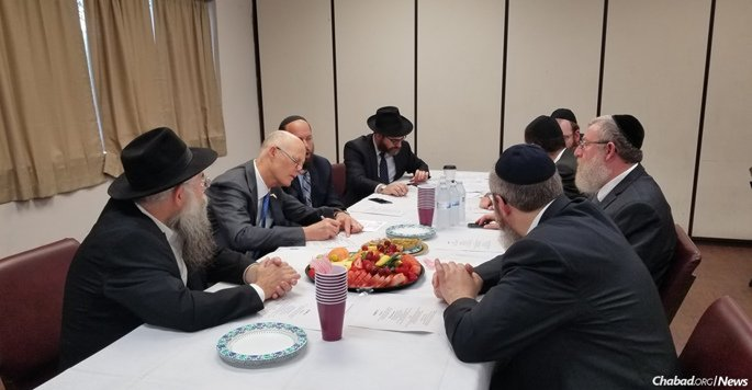 Florida Gov. Rick Scott held a working meeting with Parkland and Coral Springs-area Chabad rabbis, whose communities have been shattered by the Feb. 14 mass shooting at Marjory Stoneman Douglas High School. From left: Rabbi Yosef Biston, Scott, Rabbi Shuey Biston and Rabbi Hershy Bronstein. Opposite: Rabbi Yanky Denburg, Rabbi Avraham Friedman, Rabbi Yossie Denburg and Rabbi Moshe Rabin.