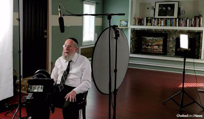 "Rabbi Yehuda Refson, Chabad emissary to the city of Leeds, England, at the filming of a course titled ""Soul Talk,"""