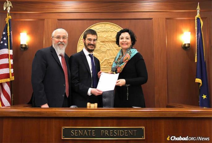 Rabbis Yosef Greenberg, left, and Mendy Greenberg with Sen. Shelley Hughes (R-Alaska) in Anchorage.