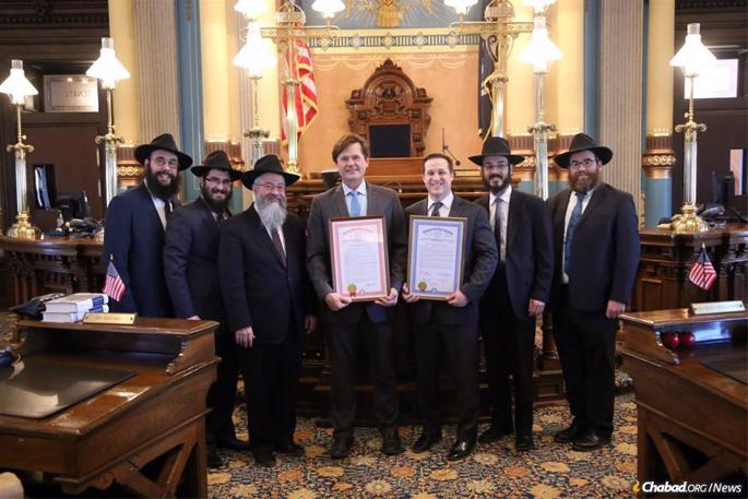 From left: Rabbis Bentzion Shemtov, Levi Dubov, Kasriel Shemtov, Mendel Stein and Alter Goldstein meet with state legislators in Michigan.