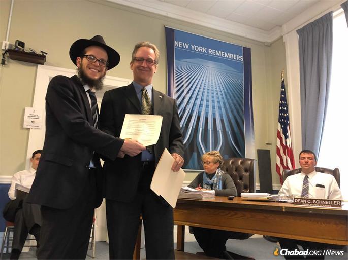 Rabbi Avrohom Rimler with Mayor Colin L. Read of Plattsburgh, N.Y.
