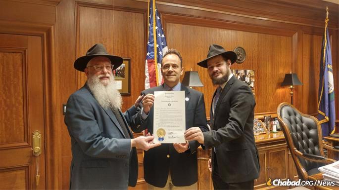 Rabbi Avrohom Litvin, left, and Rabbi Shlomo Litvin with Gov. Matt Bevin of Kentucky.