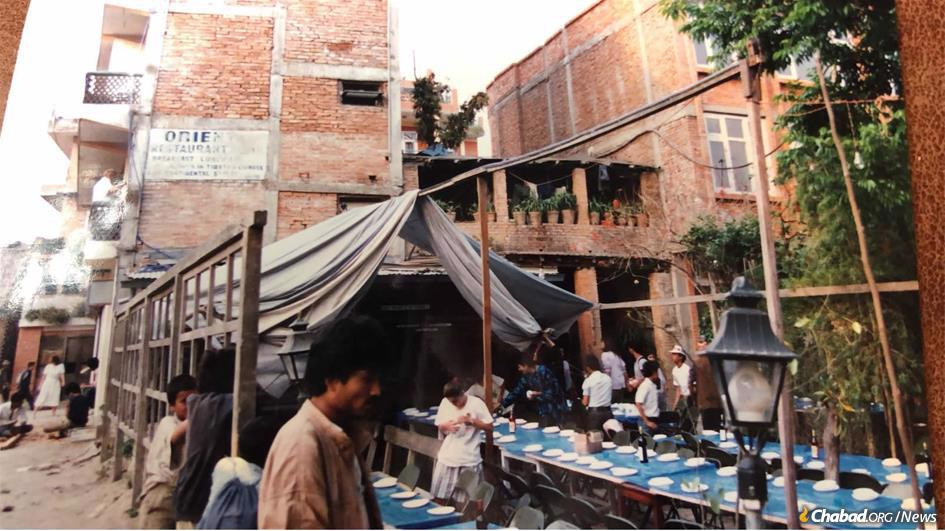 Setting up 30 years ago for the first Chabad-Lubavitch Seder in Kathmandu, Nepal. (Photo: Mendel Kastel)
