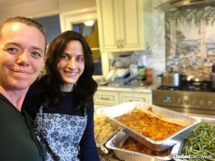 Kauai resident Leah Adelson, left, and Zisel Goldman, co-director of Chabad Kauai, prepare meals for victims and rescue workers.