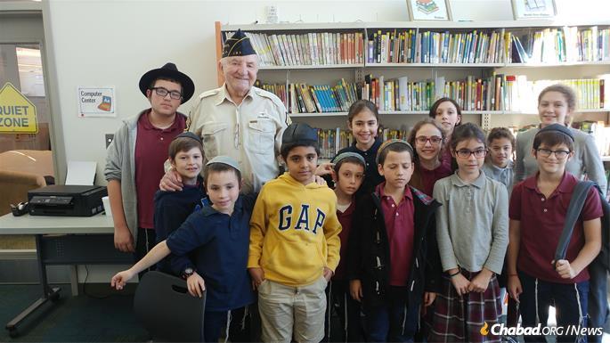 Students meet with a U.S. veteran.