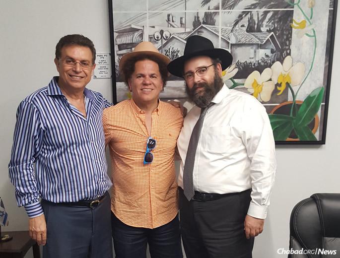 Chabad supporter Dror Zadok, left, with artist Romero Britto and Rabbi Shmuel Gopin