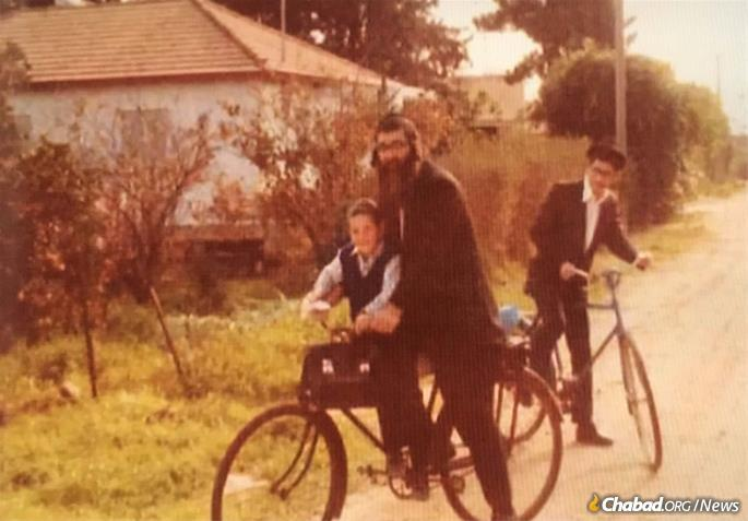 Greenwald spent his free time immersed in Torah study, riding his bike wherever he went in Kfar Chabad, a memorable sight for visitors and locals in the Chassidic village. This rare juxtaposition was reflected in his intellectual interests as well.