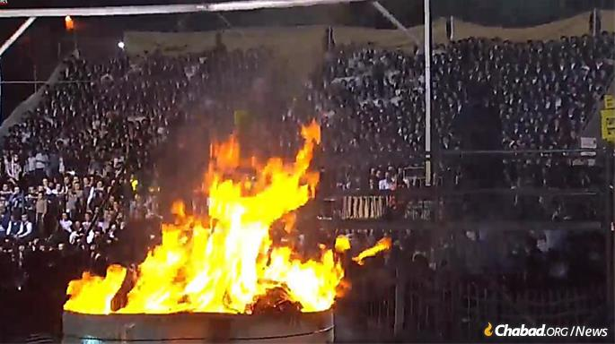 There was singing and words of Torah around a giant bonfire. (Photo: Channel One)