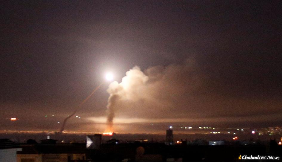 Israel attacked Iranian bases throughout Syria, killing at least 23 fighters, after Iranian forces fired missiles at Israeli positions in the Golan Heights.