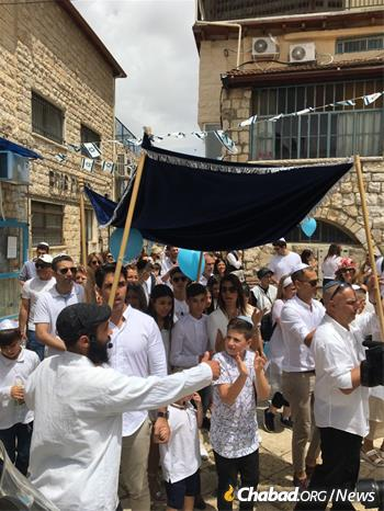 Despite recent military activity, life went on as usual in Israel's north, like at this bar mitzvah celebration in the streets of Safed.