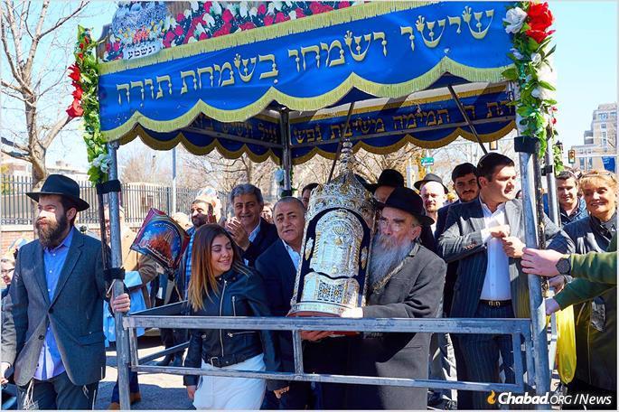 Rabbi Abraham Shemtov, regional director of Chabad of Greater Philadelphia, accompanies the Torah.