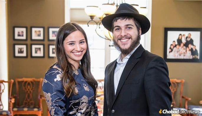 Jacob Niebloom, the sole participant in University of Rochester's alternative graduation ceremony, with his fiancee, Talia Rosenstrauch.