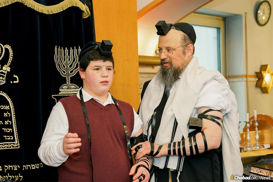 Zalman Diskin celebrates his bar mitzvah at the Munich, Germany, synagogue led by his father, Rabbi Yisroel Diskin, above.