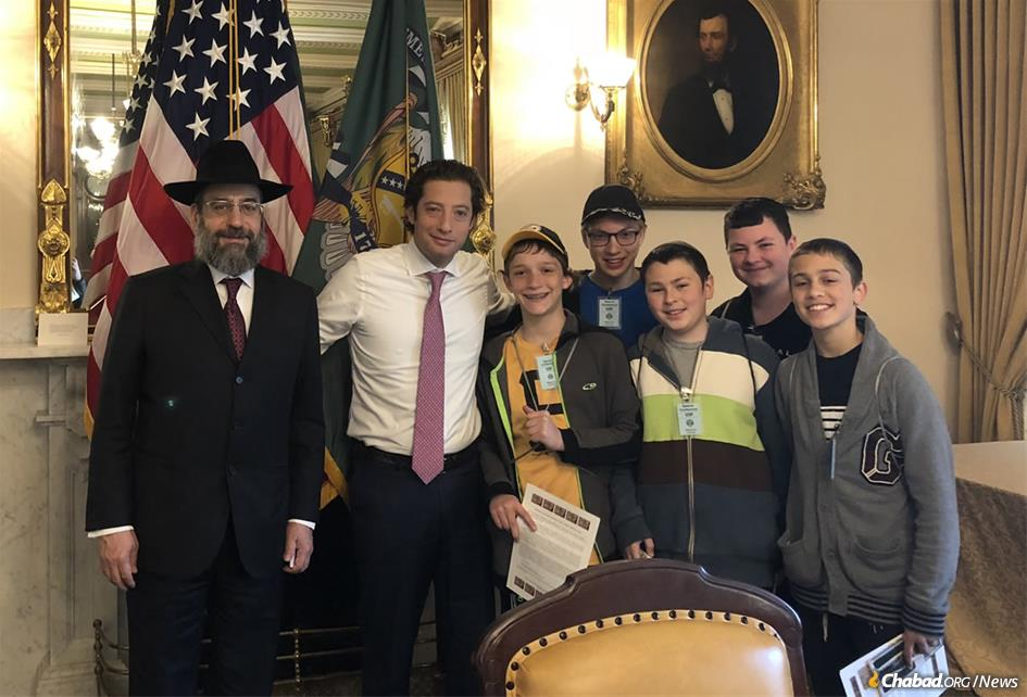 From left: Deputy Assistant Secretary of the Treasury Moyshe (Mitchell) Silk, Treasury Chief of Staff Eli Miller, and students Aaron Linder, Aaron Blanks, Noson Sollish, Daniel Bland and Dovi Lipskier gather in the Diplomatic Reception Room at the Treasury Building in Washington, D.C.