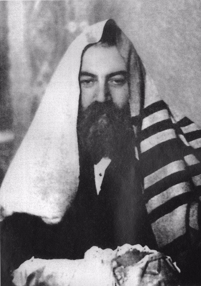 Mordechai Dubin serves as sandek at a brit milah ceremony.
