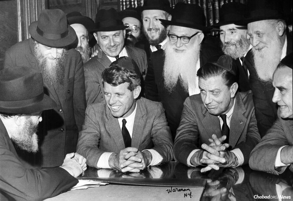 From left, seated: The Rebbe, Robert F. Kennedy, Franklin D. Roosevelt Jr. and Averell Harriman. (Photo: JEM/The Living Archive)
