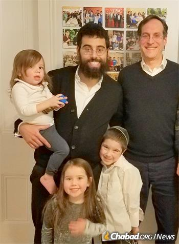 Hamilton grad Adam Eilenberg visits with Rabbi Waks