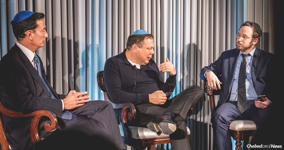 From left: Business leaders and philanthropists Matthew Bronfman and Mikhail Fridman speak about the importance of Torah for Jewish continuity at an event hosted by Rabbi Mendel Kalmenson, Chabad-Lubavitch emissary in the Belgravia section of London. (Photo: Ramis Karamatov)