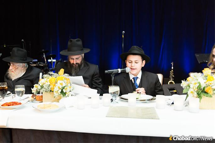 The bar mitzvah boy shares Torah learning at the celebration. (Photo: Norina Kaye)