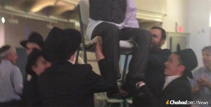 Yeshivah students from Mesivta Menachem in Hastings-on-Hudson help Joshua celebrate.