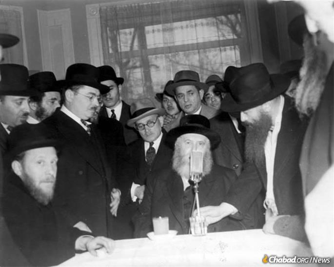 The Sixth Rebbe, Rabbi Yosef Yitzchak Schneersohn, of righteous memory, addressing a Chassidic gathering in the early 1940s in Lakewood, N.J.