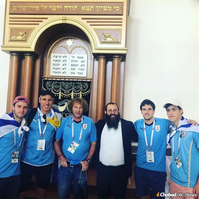 Rabbi Chaim Danzinger shows visitors around the restored Rostov synagogue.