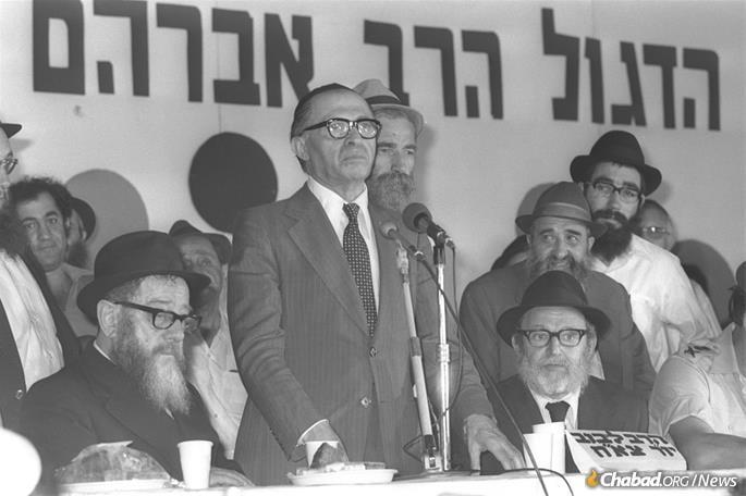 Israeli Prime Minister Menachem Begin addresses a bar mitzvah ceremony for the sons of fallen soldiers in Kfar Chabad, 1977. (Photo: Moshe Milner)