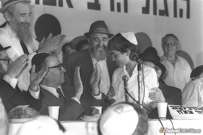 Begin, seated at left, and guests applaud bar mitzvah boy Shai Cohen. (Photo: Moshe Milner)