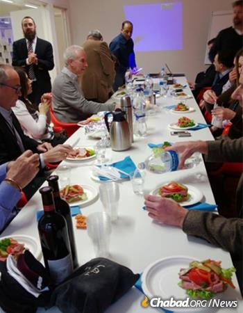 Rabbi Benyamin Wolff hosts a lunch for business leaders, complete with tefillin-wrapping.