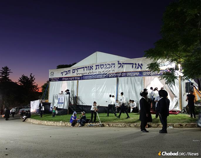 For the third year, Chabad of Safed set up a wedding-size air-conditioned tent near the tomb to provide some 6,000 meals and a place to rest, pray and learn for visitors. (Photo: Jodi Sugar)