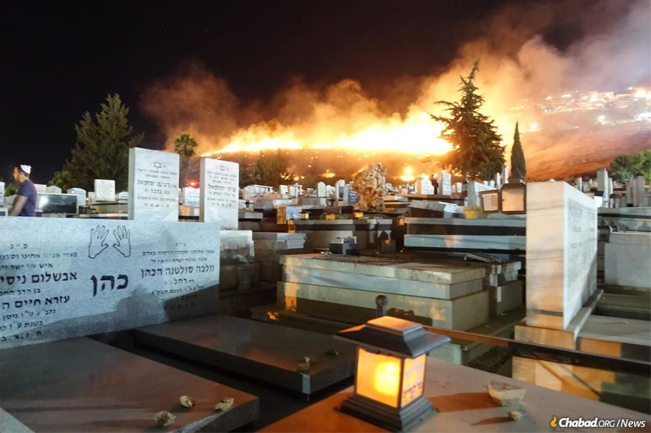 Fire blazes across the ancient Safed cemetery amid the annual pilgrimage to the tomb of the Kabbalistic sage, Rabbi Isaac Luria. (Photo: Jodi Sugar)