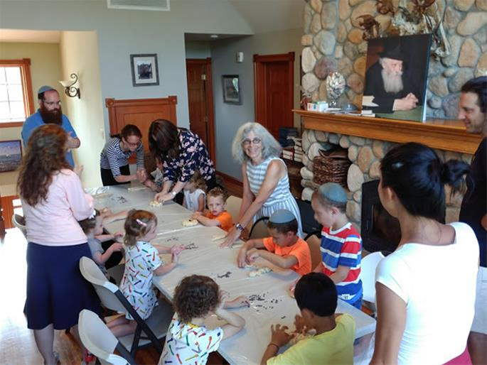 Children, parents and grandparents gather in Montauk to bake challah for Shabbat.