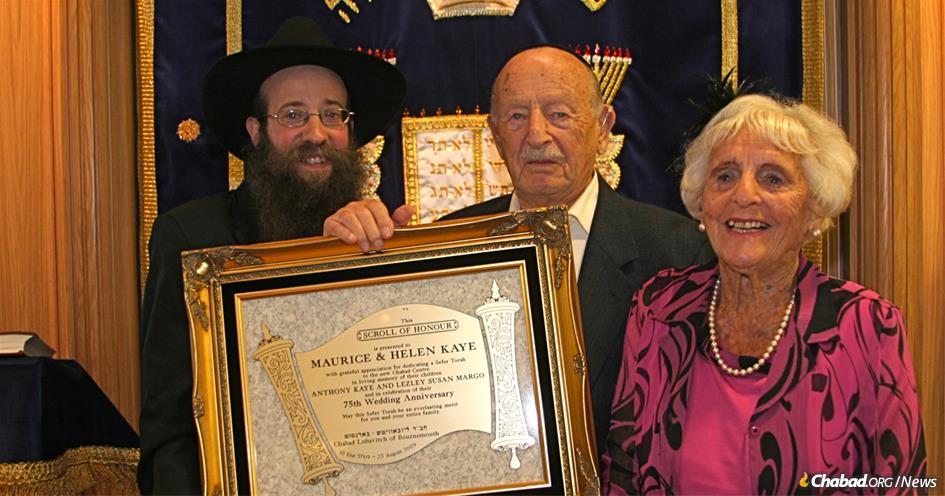 Maurice and Helen Kaye with Rabbi Yosef Alperowitz at a Torah dedication in 2009. The Torah was dedicated on their 75th wedding anniversary in memory of their children, Lezley Margo and Anthony Kaye.
