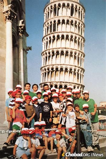 Generations of Jewish campers have spent their summers at Gan Israel, seen here at the Leaning Tower of Pisa in the early 1990s.