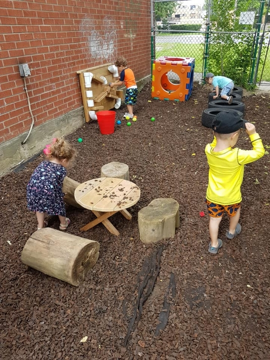 kinderplayground- balls and tires and table.jpg